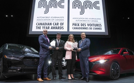 The Jaguar I-PACE, 2020 AJAC Canadian Utility Vehicle of the Year, left, and the Mazda 3, 2020 AJAC Canadian Car of the Year at the 2020 Canadian International AutoShow in Toronto, Ontario.